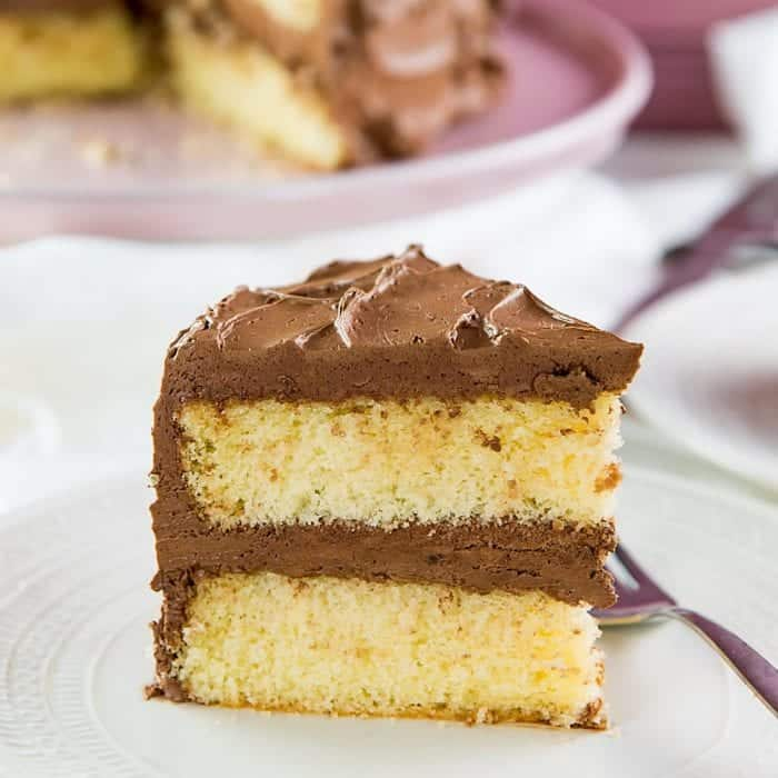 Best Vanilla Cake - Delightfully soft, buttery, classic vanilla cake with a creamy chocolate or vanilla frosting! With heaps of tips to get perfect cakes every single time