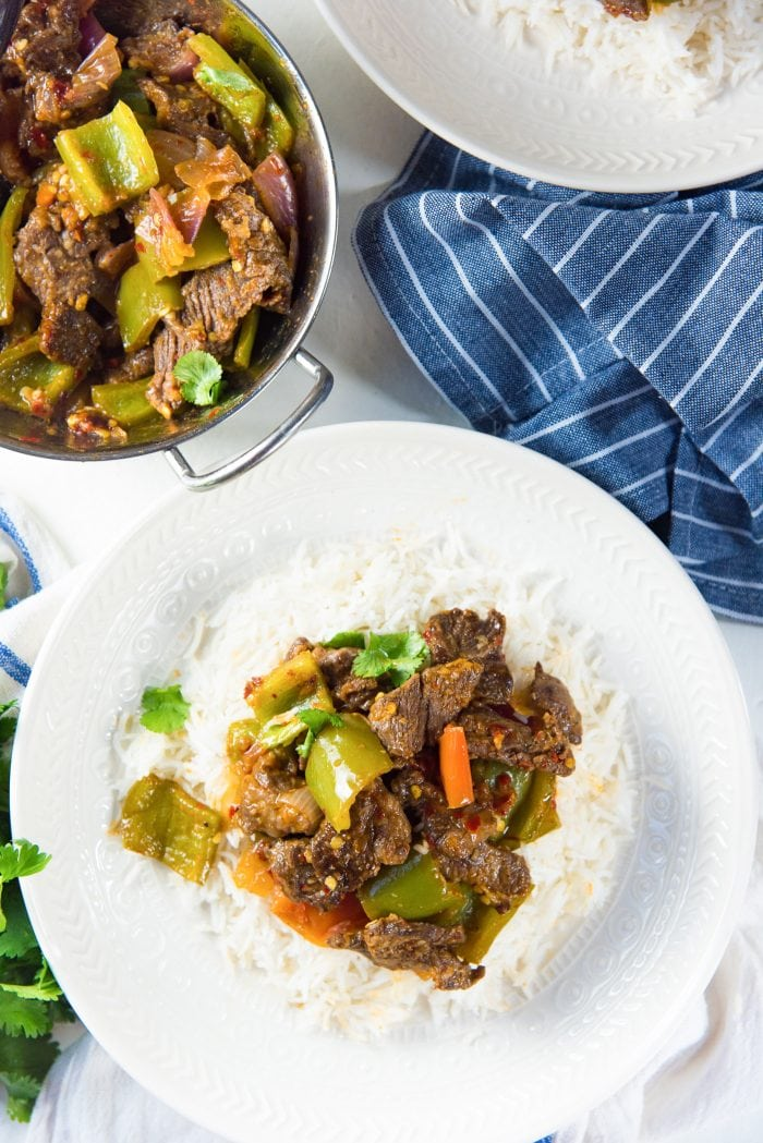Sri Lankan Devilled Beef - Spicy Dry Beef Curry served with a plate of rice.