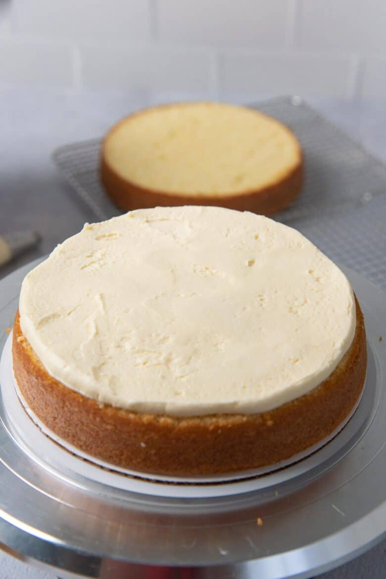 The buttercream spread evenly on the cake layer