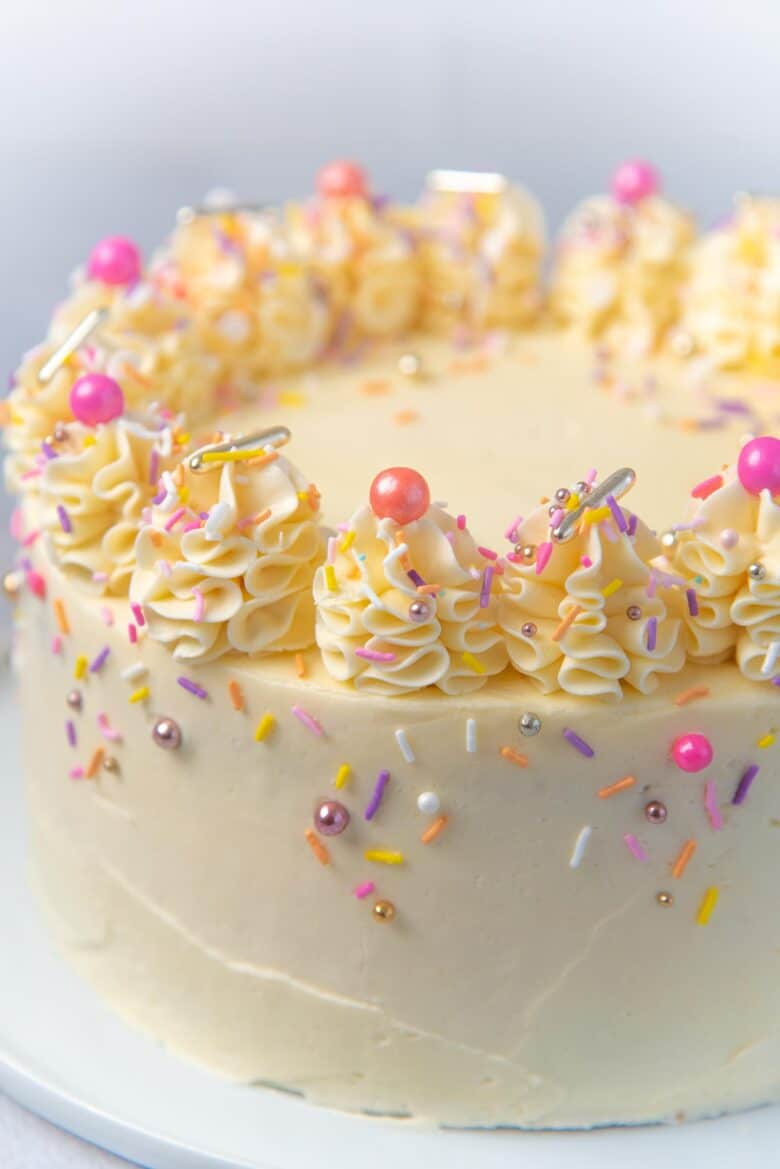 A close up of the decorative detail on the vanilla birthday cake