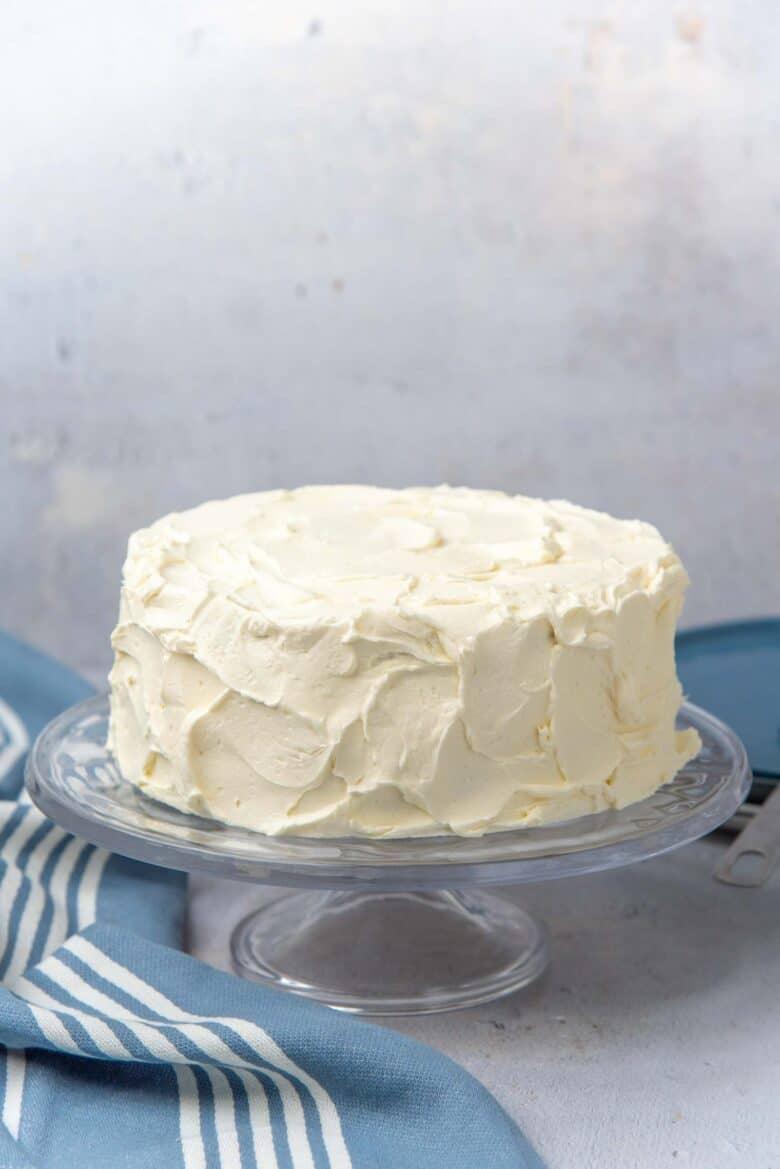 A rustic vanilla cake with swirled vanilla buttercream