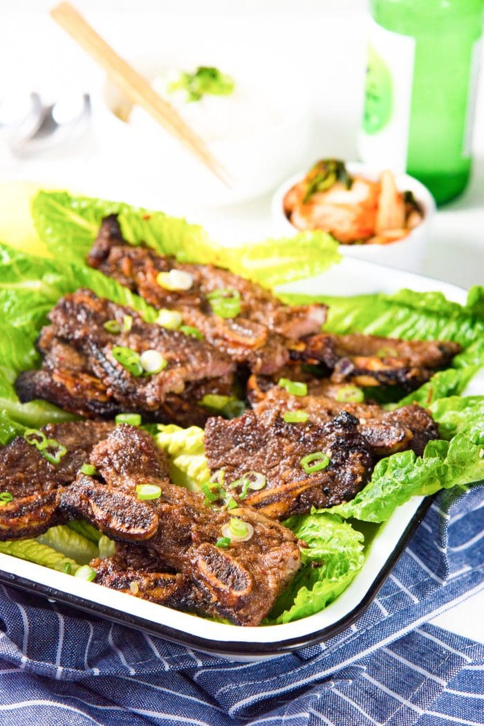 LA Galbi (Korean BBQ Short Ribs) - Serve Korean BBQ beef with Salad leaves and other side dishes for a great dinner or lunch.