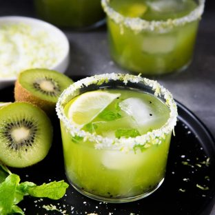 Mint Kiwi Margarita - A delicious margarita with tangy kiwi fruit, and refreshing mint! Perfect Summer sipper. Make individual cocktails or a batch mint kiwi margarita punch!