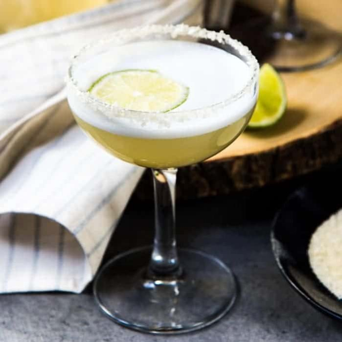 Smoked Margarita Sour - A sophisticated twist on a classic margarita, made with cherry wood smoked tequila. The cocktail foam is created with aquafaba, making this margarita sour cocktail vegetarian/ vegan too!