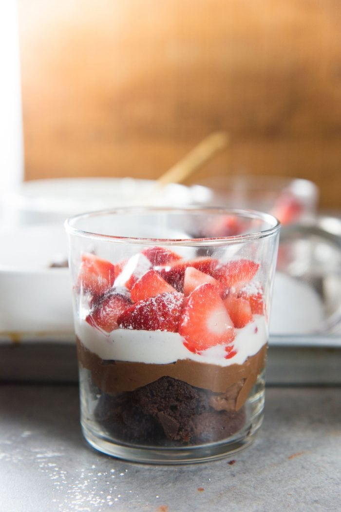 Strawberry Chocolate Brownie Trifle - Later all the ingredients in individual serving glasses, so that it's easier to serve and looks pretty. A glass is perfect because you can see the layers in this trifle too.