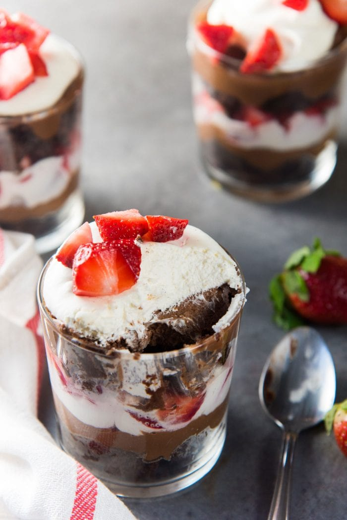Strawberry Chocolate Brownie Trifle - Layers of fudgy chocolate brownies, chocolate pastry cream with Fresh strawberries and cream! So simple to assemble, and tastes amazing!