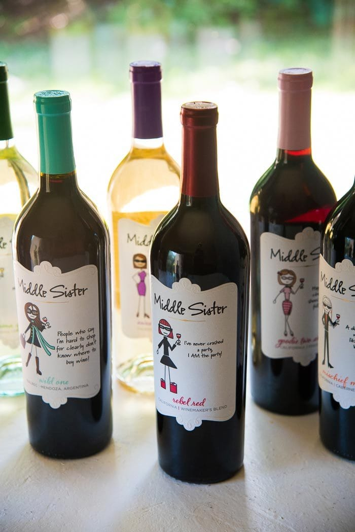 Bottles of Middle Sister Wines on a white table