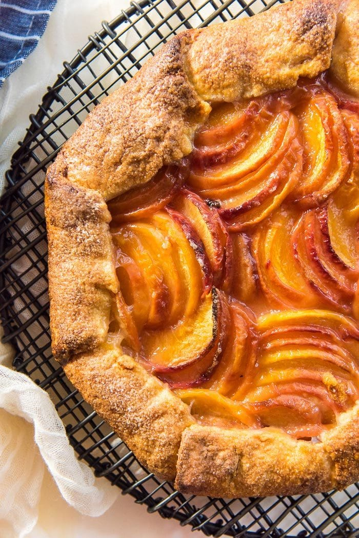 Overhead of the peach galette. Showing the slices of peaches forming a grid like pattern.
