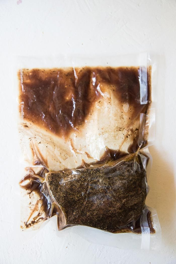 A cooked rump roast, in the vacuum packed bag,