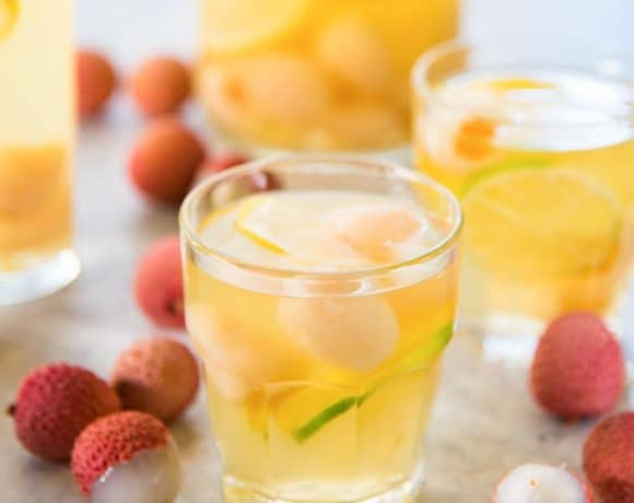 Ginger Lychee Sangria Blanca - An ice-cold, boozy Pinot grigio sangria drink with an explosion of flavors, perfect for hot summer days and evenings!