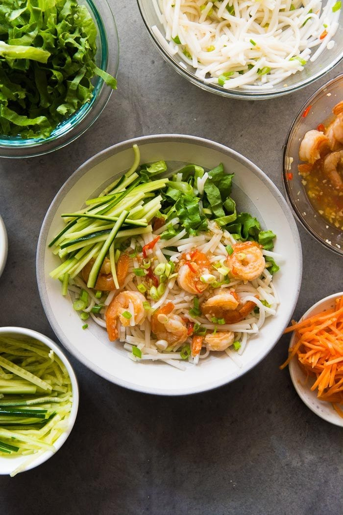 Assembling Garlic Lime Shrimp Rice noodle salad. Add the julienne cucumbers