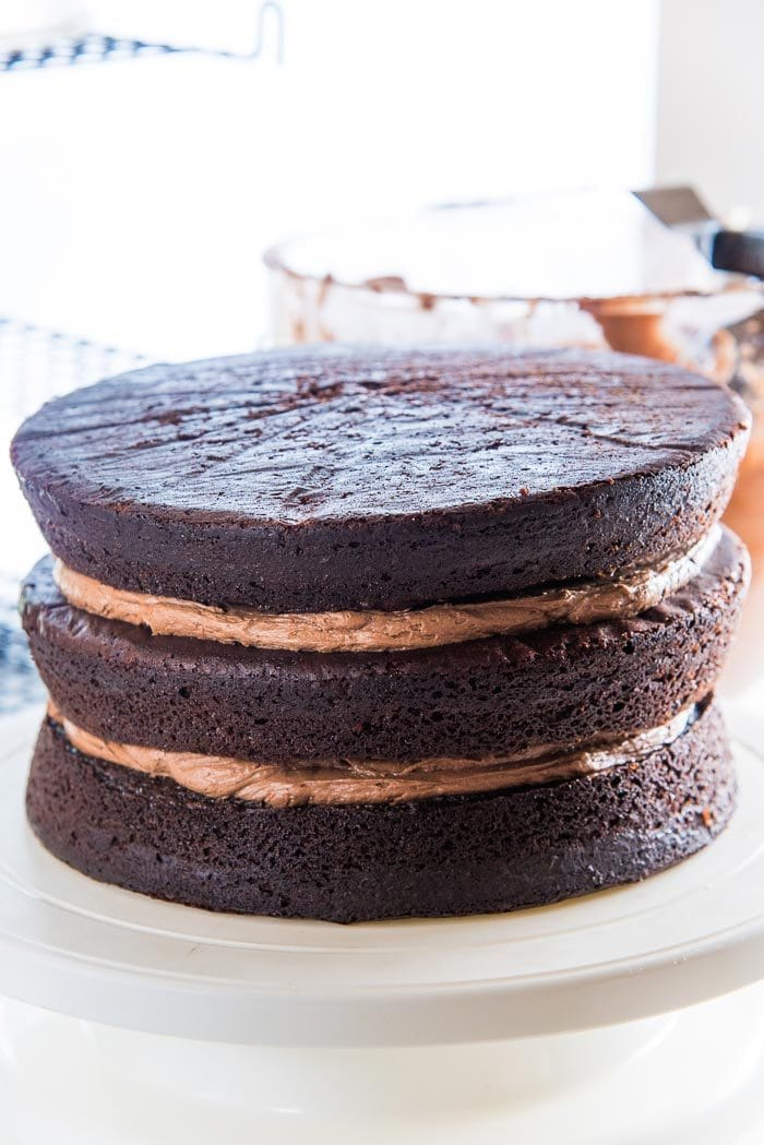 Repeat until all chocolate cake layers have been placed on top of each other.
