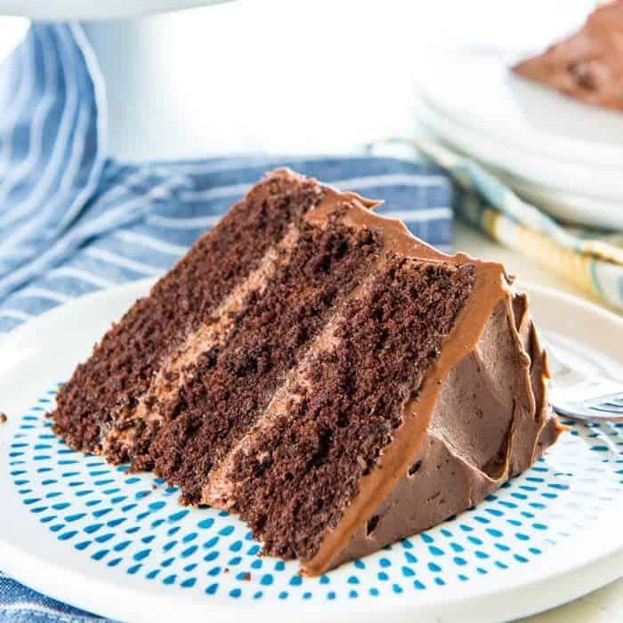 This Classic Chocolate Cake is the only and best chocolate cake recipe you will ever need! It has layers of soft, airy chocolate cake layers, with a creamy, buttery, melt in your mouth Chocolate buttercream frosting. Perfect cake for Birthday cake, or any occasion.