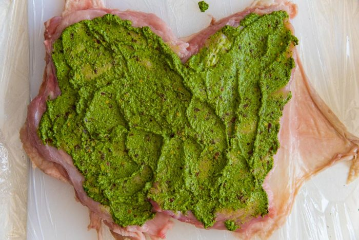 Spread out the herb mix on the butterflied turkey breast meat.