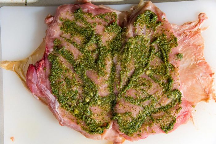 Spread the marinade or spice rub evenly so that it will get into the cuts made on the meat as well.