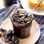 This Homemade Concord Grape Jelly recipe (Concord Grape Jam) is so easy, and so delicious! Perfectly tart and sweet and perfect on everything!