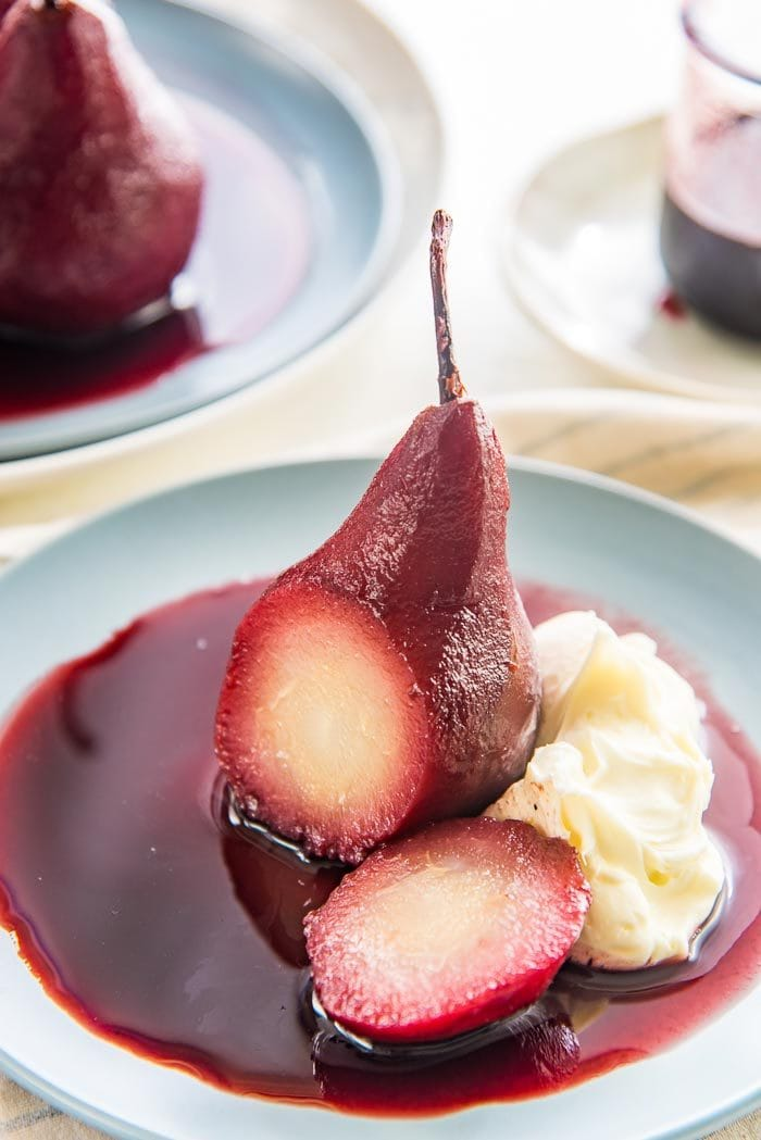 Red Wine Poached Pears - a simple and easy recipe that is absolutely elegant! Get tips to perfect this sweet and spiced simple pear dessert.