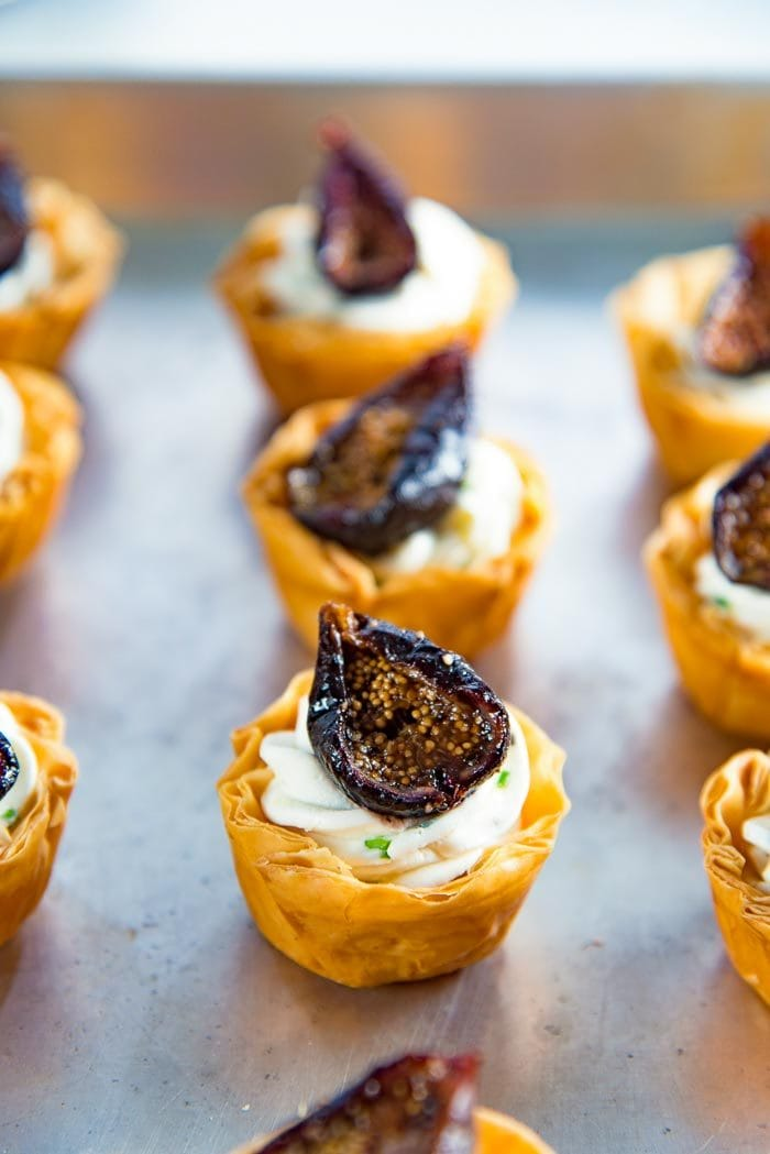 Top each goat cheese phyllo cup appetizers with a roasted fig.