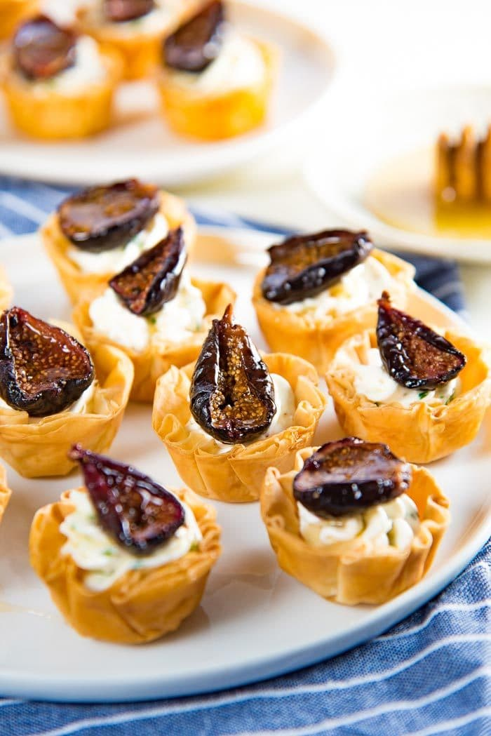 Goat Cheese and Roasted Fig Tartlet - Sweet, savory, creamy and crunchy all in one bite. These appetizers can be made a few days ahead of time, and the recipe is also very adaptable. #HolidayAppetizers #PhylloCupAppetizers #FigTartlet #FigRecipes