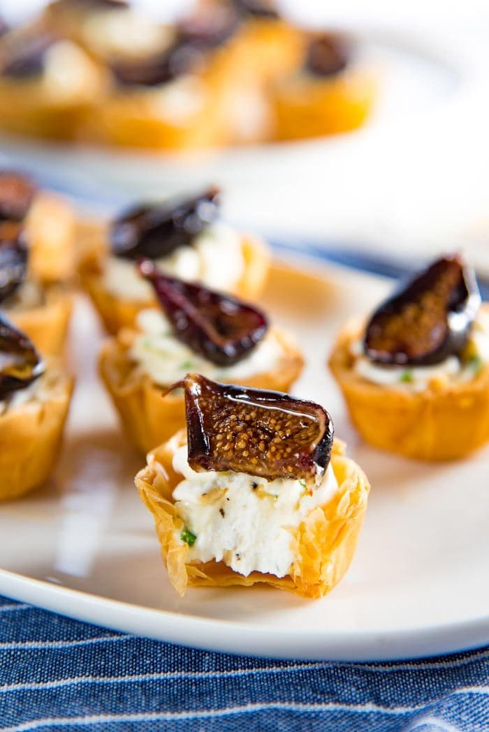 A close up of a roasted fig tartlet, cut in half.