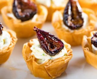 Goat Cheese and Roasted Fig Tartlet - Sweet, savory, creamy and crunchy all in one bite. These appetizers can be made a few days ahead of time, and the recipe is also very adaptable.