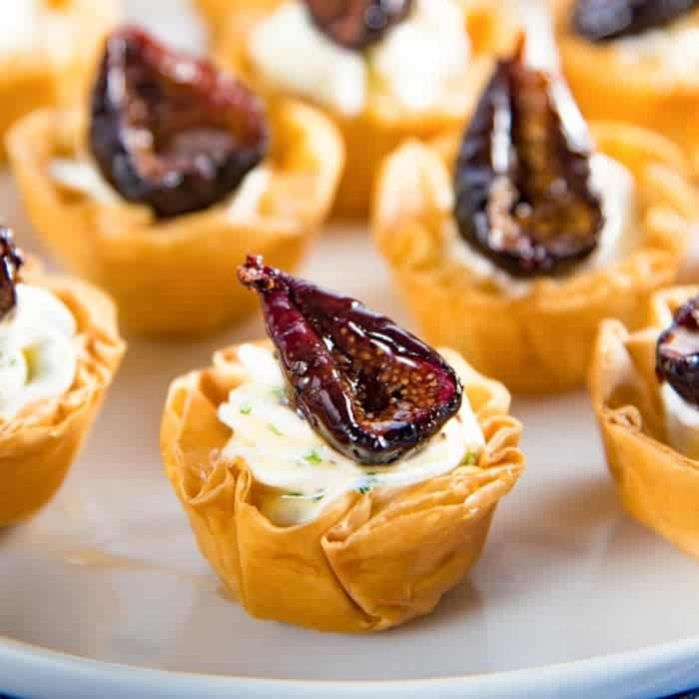 Goat Cheese and Roasted Fig Tartlet -Sweet, savory, creamy and crunchy all in one bite. These appetizers can be made a few days ahead of time, and the recipe is also very adaptable.