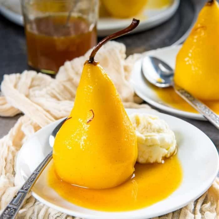 Saffron Poached Pears - a delicious and simple dessert that looks impressive! Saffron and cardamom makes this dessert luxurious and exotic, with a little spicy kick. Perfect dessert for a dinner party.