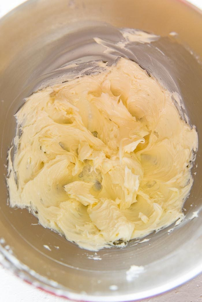 Butter and salt mixed together in a mixing bowl.
