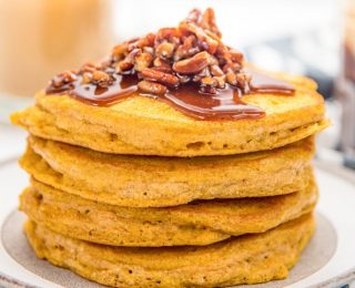 Easy Pumpkin Pancakes - Deliciously fragrant, light and fluffy pumpkin pancakes, spiced with pumpkin spice and pumpkin puree and topped with a maple pecan topping! It's even easier to make with the pancake waffle mix!
