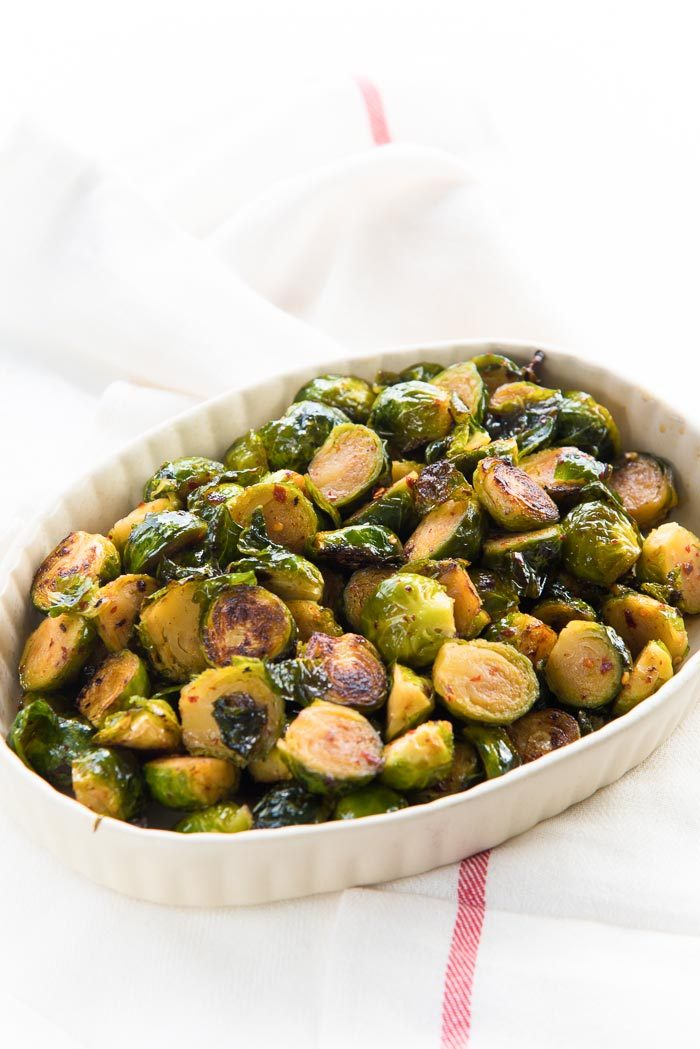Oven roasted brussels sprouts one of many Thanksgiving side dishes, and easy to make. Serve with any roast.
