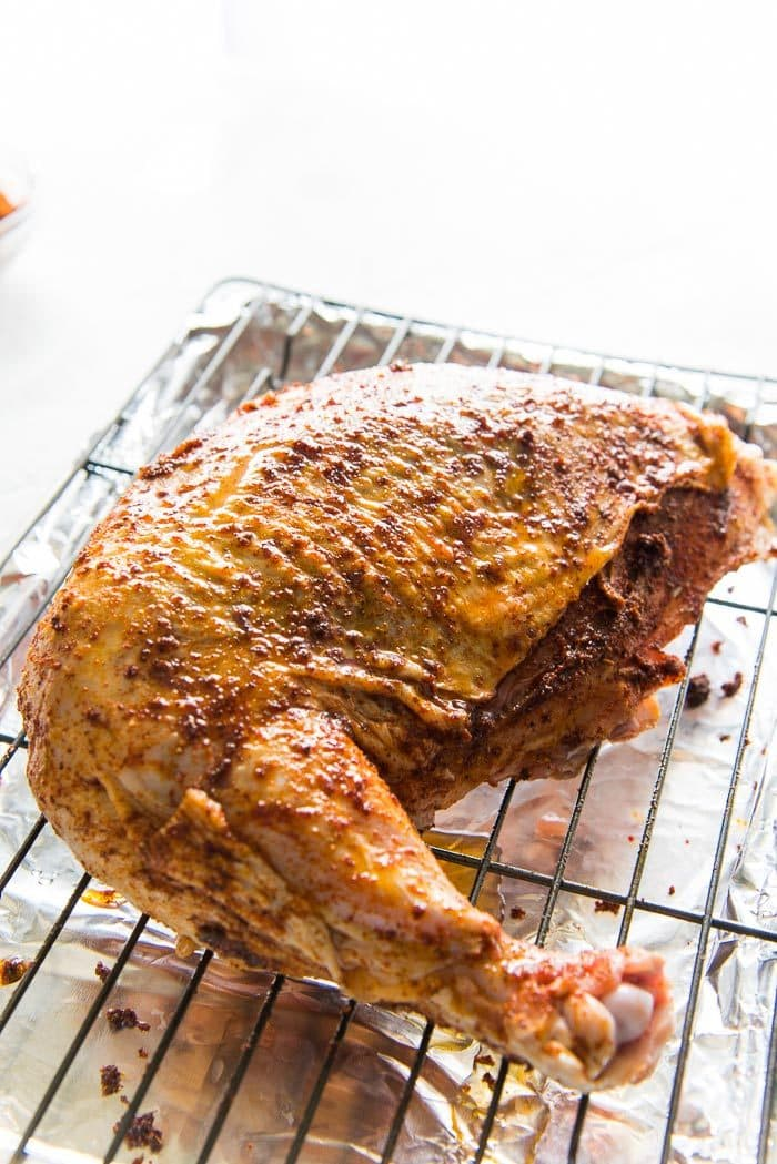 A Cajun spice rubbed Frenched Turkey breast cut on a roasting rack.