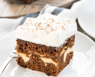 Cheesecake Stuffed Gingerbread Cake - Sweet, and spicy gingerbread cake with a fudgy, creamy hidden cheesecake layer inside! A double dessert in one cake that's perfect for the holidays.