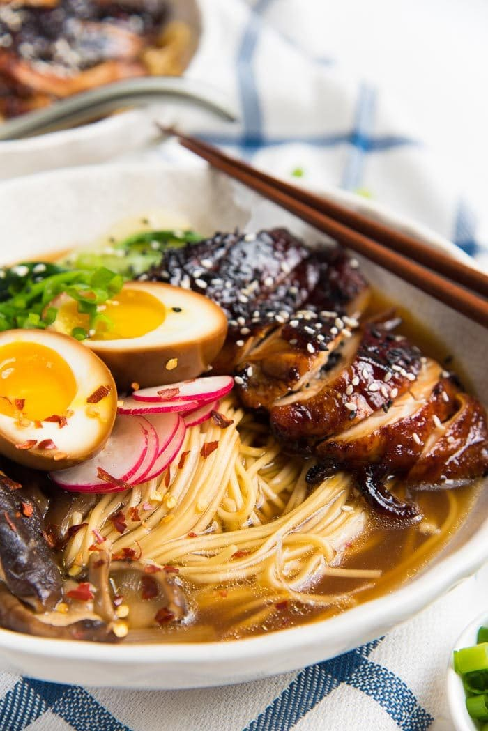A close up of the bowl of ramen, showing the shoyu ramen broth.