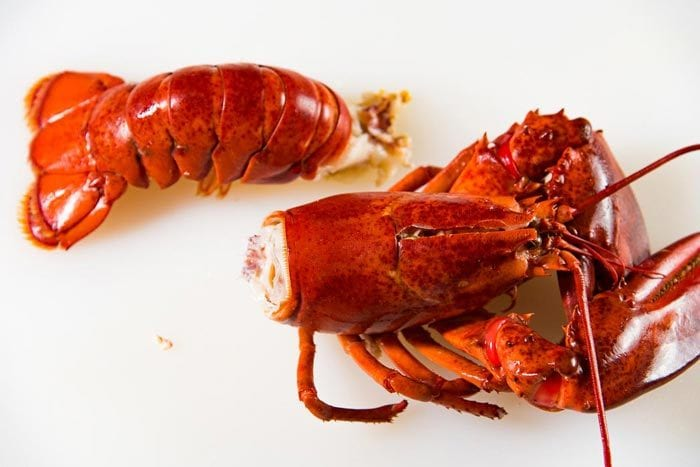 A separated lobster body and lobster tail