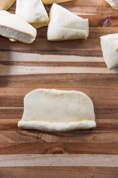 Process of making New England Hot Dog Buns (Lobster roll buns) - Roll up the piece of dough to form a tube.