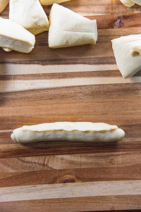Process of making New England Hot Dog Buns (Lobster roll buns) - Pinch the edge of the dough to seal the seam.