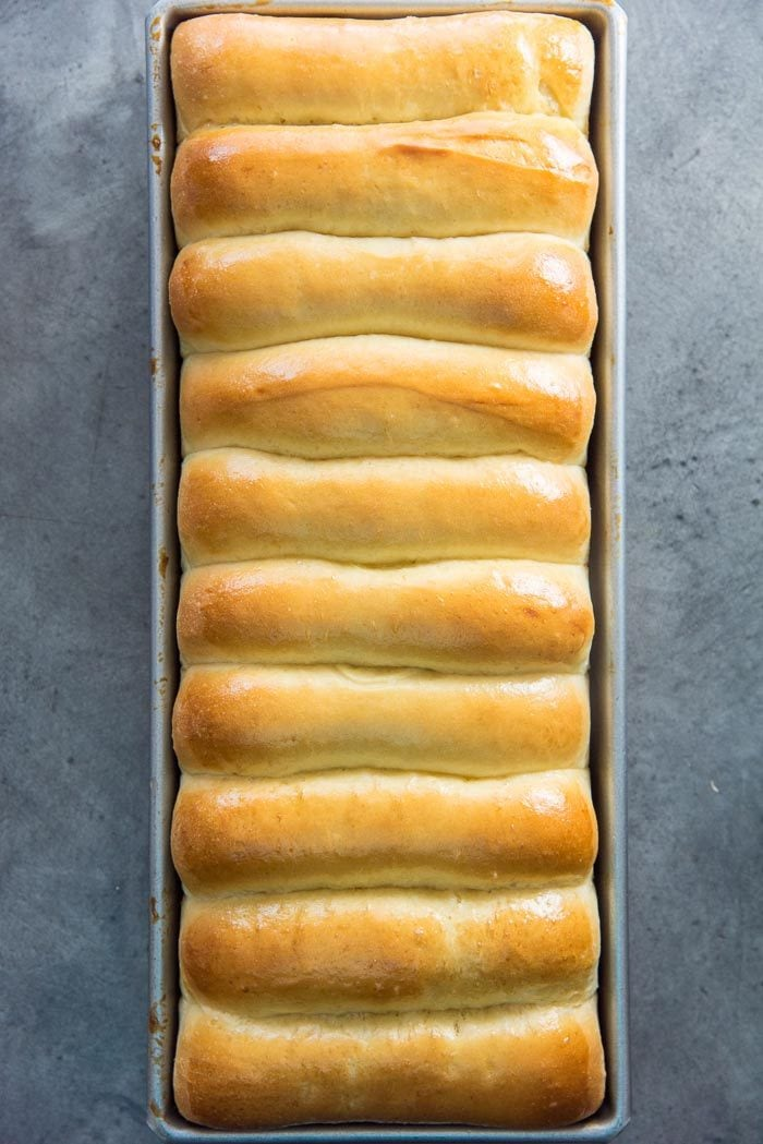 Freshly baked New England Hot dog buns (top split hot dog buns) still in hot dog buns.