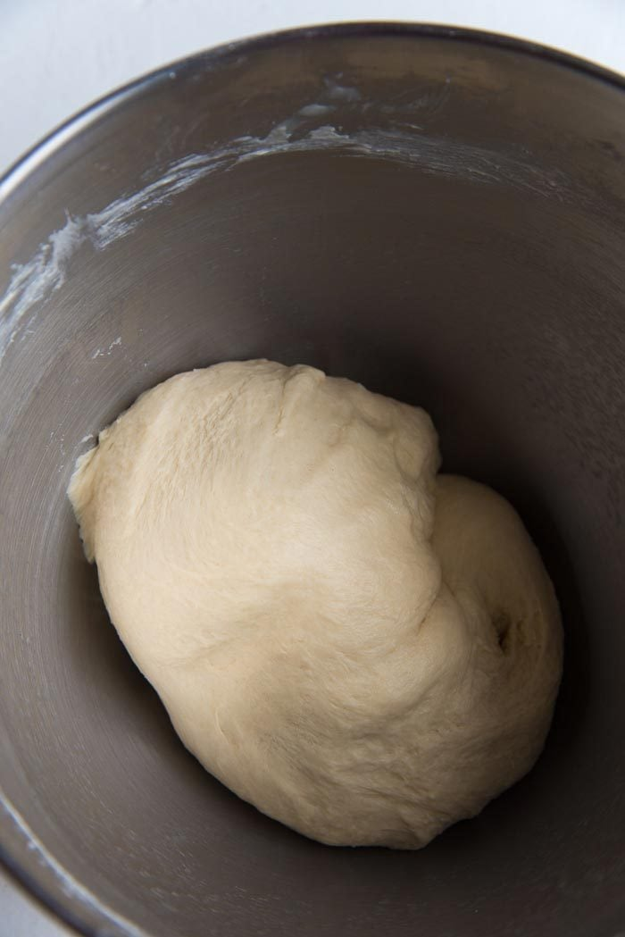 Process of making New England Hot Dog Buns (Lobster roll buns) - Dough that has been mixed in the mixer bowl. The dough is soft, and shiny.