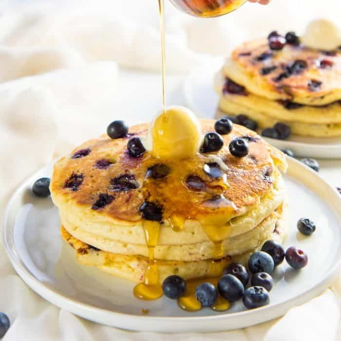 Fluffiest Blueberry Pancakes - Delicious blueberry pancakes to start the day with juicy and sweet blueberries. Make them with a pancake mix or from scratch, but either way will be fluffy and amazing.
