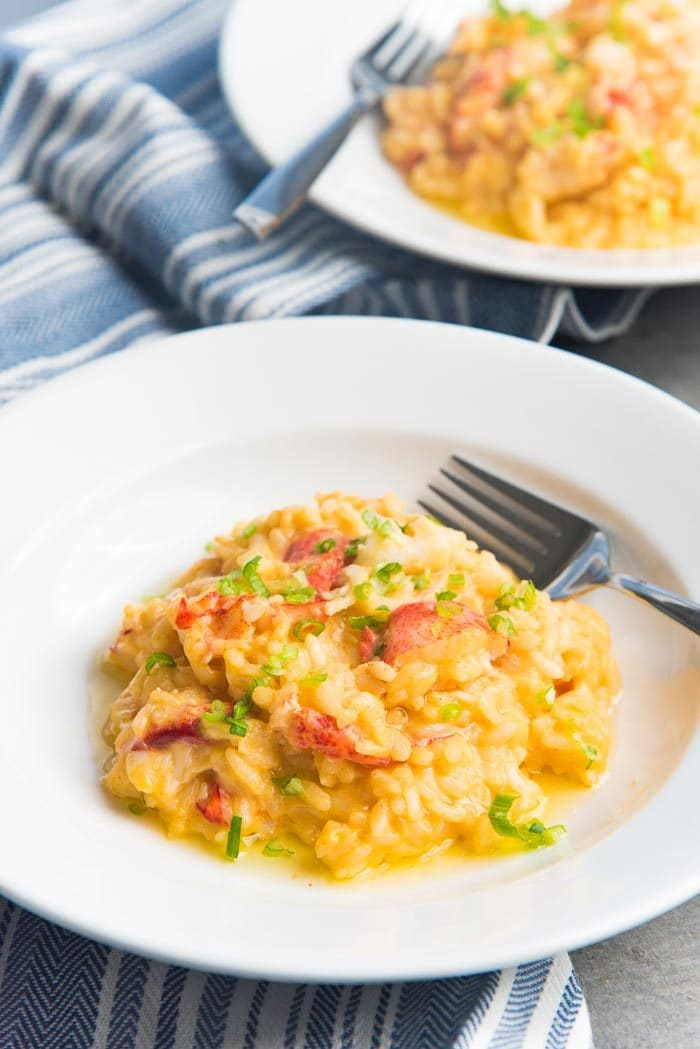 Butter Lobster Risotto - Elegant, delicious and creamy lobster risotto, with chunks of butter poached lobster and a drizzle of brown butter. Perfect romantic meal for two or for guests at a dinner.
