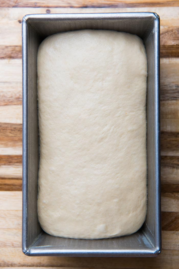 Place the dough into the loaf pan, with the smooth side facing up.