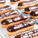 Classic Chocolate Eclairs - A foolproof recipe for making perfect eclairs that are crisp and puffy and filled with chocolate or vanilla pastry cream.