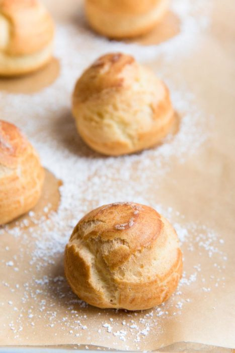 Learn how to make Perfect Choux Pastry (Or Pate a Choux!) - The only recipe guide you will ever need to make choux pastry, with perfect results every time. Plus a troubleshooting guide for your choux pastry recipe.  Fool proof choux pastry to make profiteroles, eclairs, cream puffs and more.