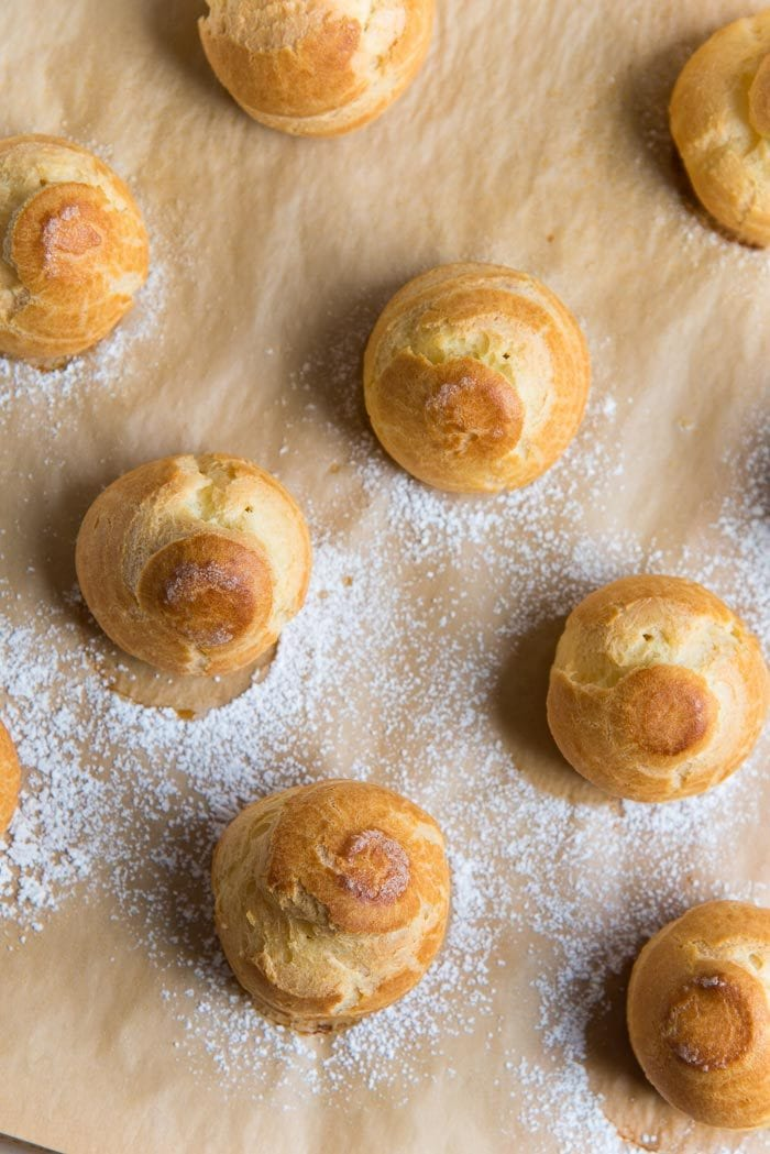 An overhead view of perfect;y baked choux pastry cases.