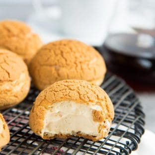 Choux au Craquelin with Salted Caramel Cream - A crispy choux pastry with a cookie crust, filled with a airy, and creamy salted caramel diplomat cream.