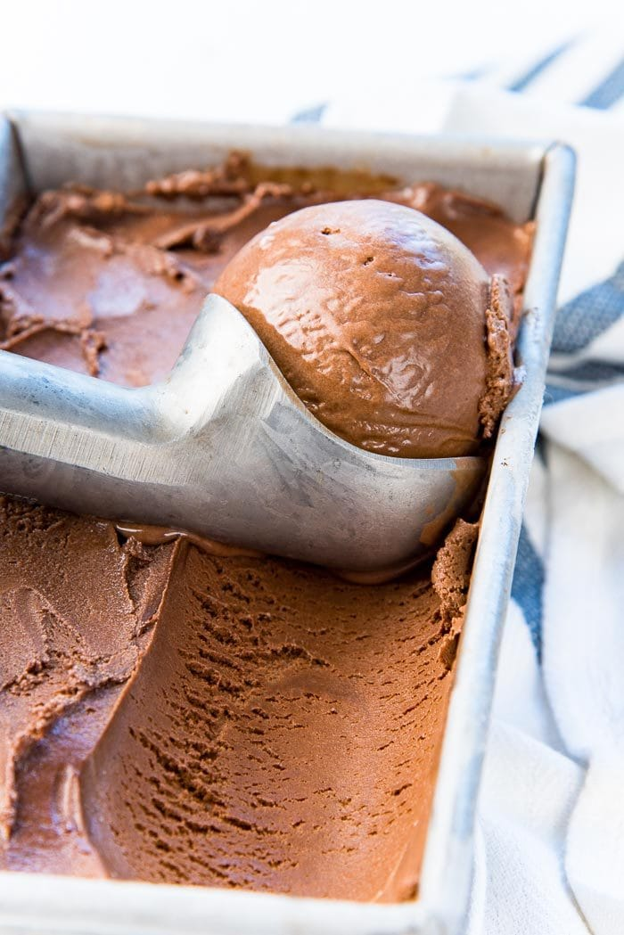 Chocolate ice cream being scooped from the frozen chocolate ice cream