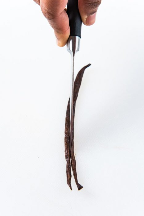 Splitting the vanilla bean with a sharp knife