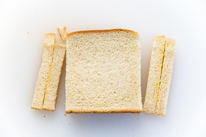 Crust cut off the sandwich bread for the egg salad sandwich