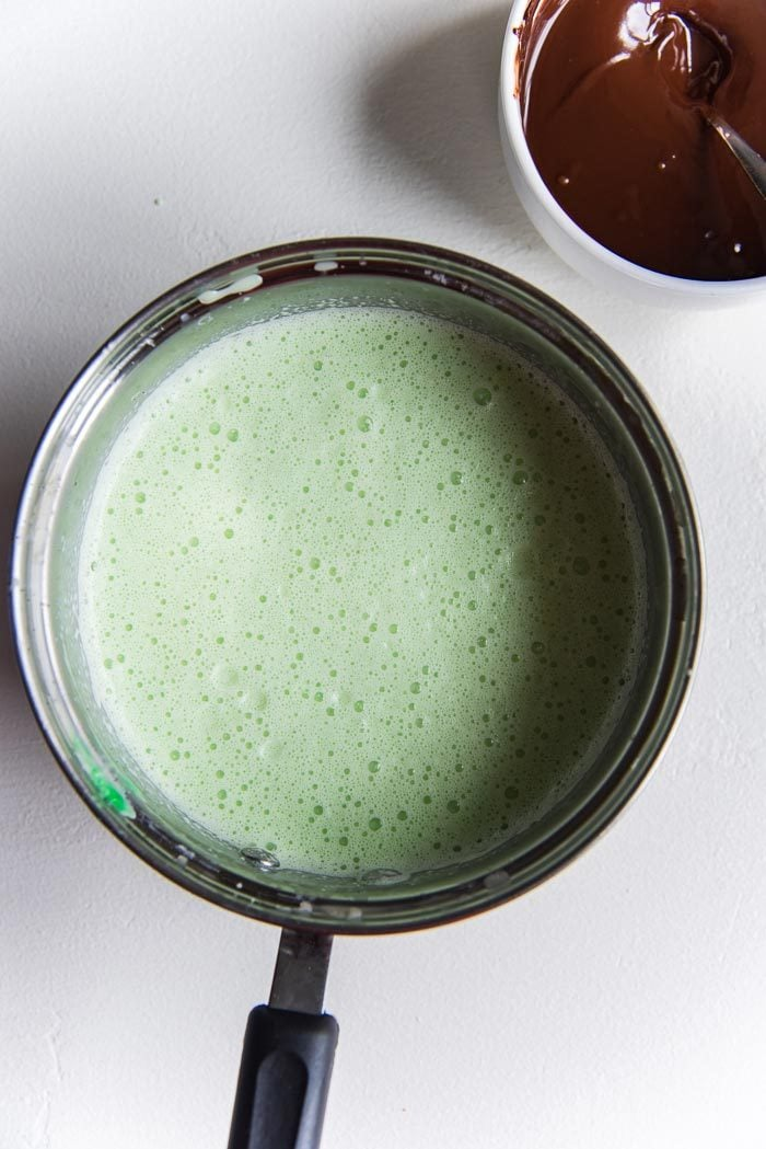 Chilled Mint ice cream base after coloring it green, in a saucepan ready to be churned.