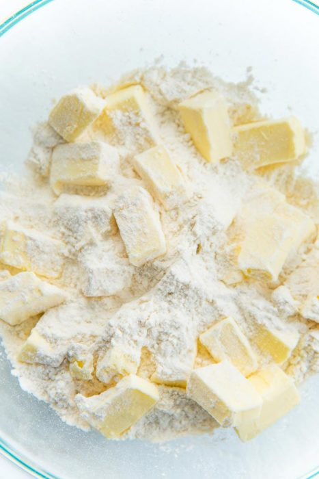 How to make a quiche crust - Chilled butter cubes in a bowl with the flour.